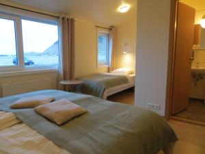 A bed or beds in a room at Guesthouse Vellir