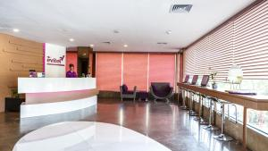 The lobby or reception area at Asialink Easy by Prasanthi formerly The Evitel