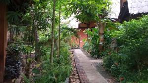 Jardín al aire libre en Mandala Ou Resort