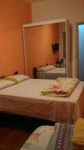 A bed or beds in a room at Hostel Vergueiro