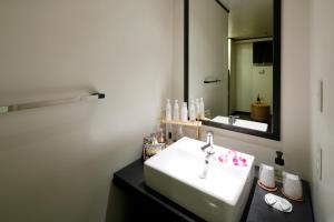 A bathroom at Hotel The Lotus Bali (Adult Only)