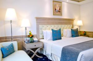 A bed or beds in a room at Royale Chulan Penang