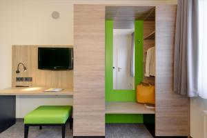 A television and/or entertainment centre at ibis Styles Halle