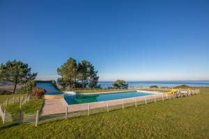 The swimming pool at or near Your Nest in Nazaré - Ocean View Villa