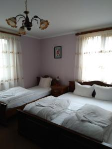 A bed or beds in a room at Guest House Todorini kashti