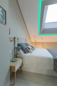 Cama o camas de una habitación en Apartamentos Inloft