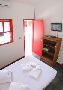 Cama ou camas em um quarto em Pousada Tamoios
