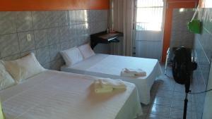 Cama ou camas em um quarto em Casa na Praia