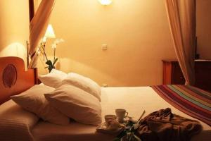 Cama o camas de una habitación en Hotel Rural & Spa Las Nubes