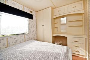 Łóżko lub łóżka w pokoju w obiekcie Anker Władysławowo