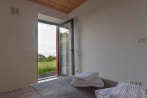 A bed or beds in a room at Casa do Cedro do Mato