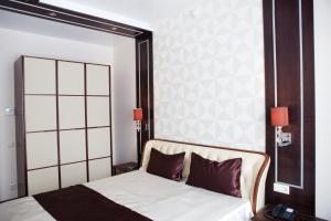Кровать или кровати в номере Бизнес Отель Абникум
