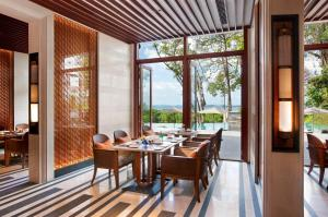 A restaurant or other place to eat at Capella The Club Residences Singapore