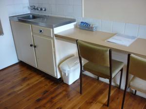 A kitchen or kitchenette at Roma Aussie Tourist Park