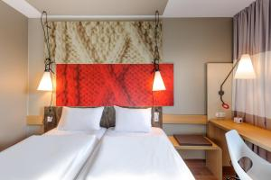 A bed or beds in a room at ibis Hotel München Messe