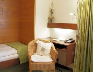 Ein Bett oder Betten in einem Zimmer der Unterkunft Akzent Hotel Landhaus Heinen