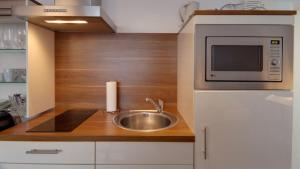 A kitchen or kitchenette at Campus Boardinghouse