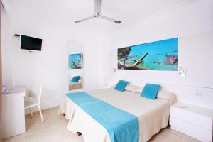 Een bed of bedden in een kamer bij Hotel Kilimanjaro
