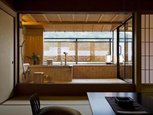 A kitchen or kitchenette at Kotohira Onsen Kotosankaku