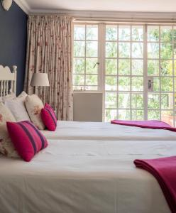 A bed or beds in a room at Patcham Place