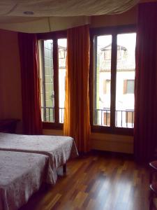 Un ou plusieurs lits dans un hébergement de l'établissement Cadoro