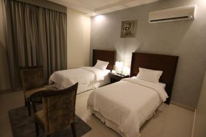 Cama ou camas em um quarto em Alsamer Homes