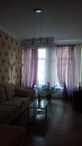 A seating area at Apartment on Fortovaya Doroga