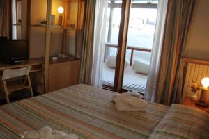 A bed or beds in a room at Hotel Il Fraitevino