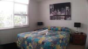 A bed or beds in a room at Oceana Holiday Units