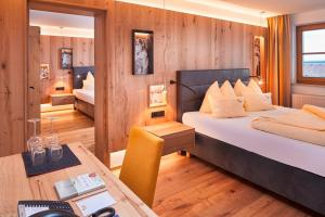 A bed or beds in a room at Bauernhof Hotel Oberschwarzach