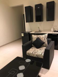 Uma área de estar em VIP Residence (Bachelors Only)
