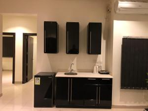 Um banheiro em VIP Residence (Bachelors Only)