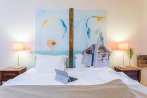 Uma cama ou camas num quarto em Hotel Fonte Santa