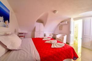 Un ou plusieurs lits dans un hébergement de l'établissement Caldera View Resort