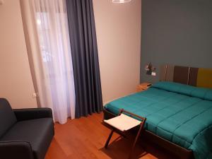 A bed or beds in a room at La Terrazza di Carolina
