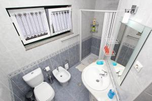 A bathroom at Guest House Pereira