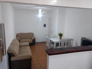 Uma área de estar em Apartamento Elvira 02