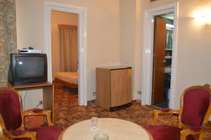 A television and/or entertainment center at Hotel Delta