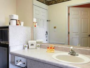 A bathroom at Days Inn by Wyndham Ocean Shores