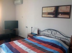 Кровать или кровати в номере Arbuzova