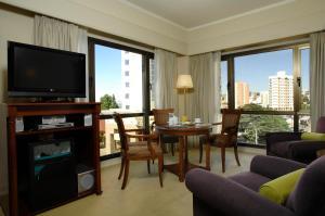 Гостиная зона в Austral Plaza Hotel