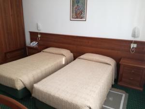 Letto o letti in una camera di Hotel Mantegna