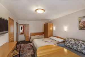 Кровать или кровати в номере Апартаменты на Сухаревской