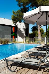 The swimming pool at or near Golden Tulip Marseille Airport