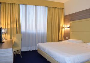 Letto o letti in una camera di Palace Inn Rome Fiano