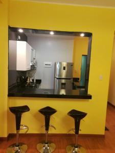 A kitchen or kitchenette at Apartamento Miraflores Boulevard Tarata