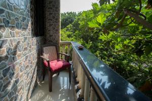 A balcony or terrace at The Noname Guesthouse