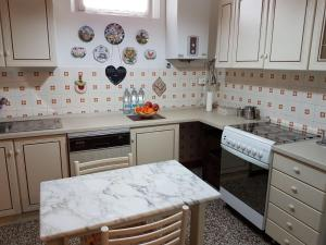 A kitchen or kitchenette at B&B Terry e Fiammi