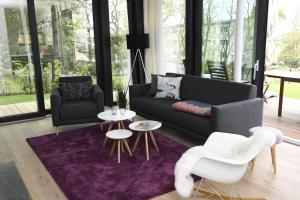 A seating area at Haus Wetterhexe - FeWo 01