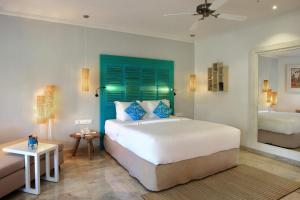 A bed or beds in a room at SOL by Meliá Benoa Bali All inclusive